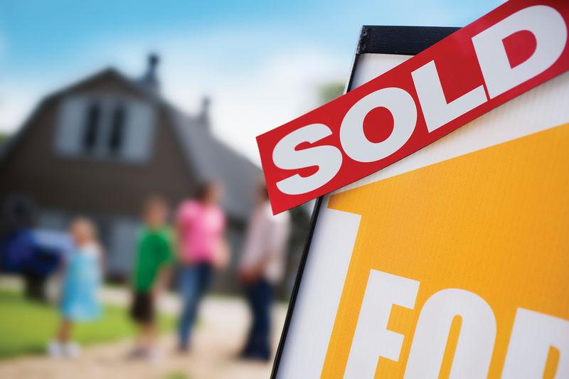 Housing Market -- Sold sign