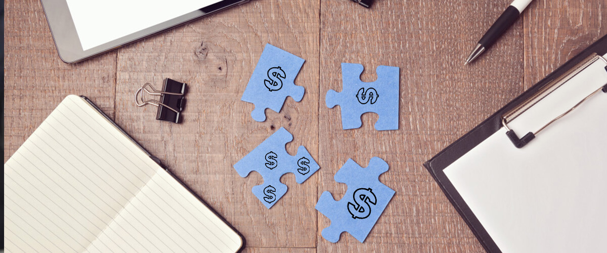 Puzzle pieces used to symbolize consolidation of credit card debt into a single loan