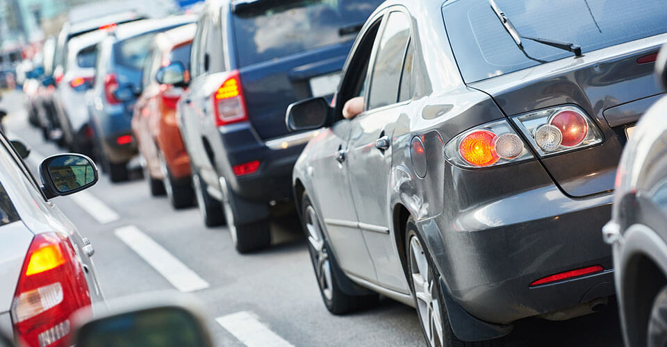 How does distance from work affect insurance rates
