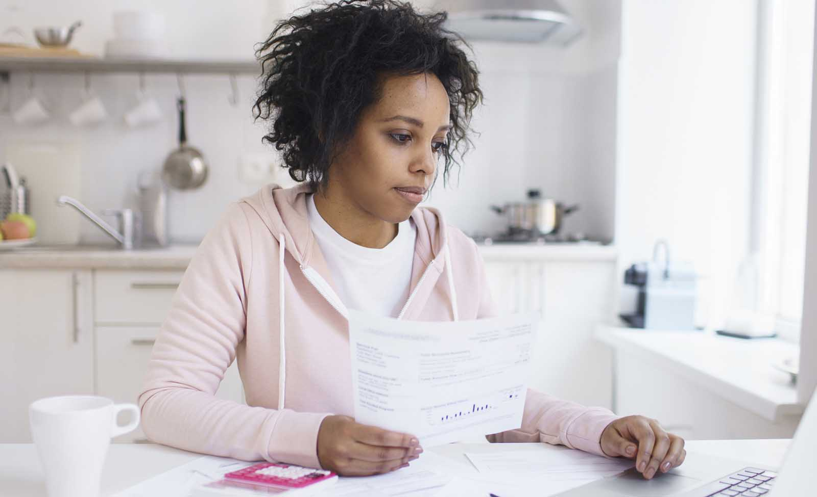 Woman researches whether you can remove student loans from your credit report