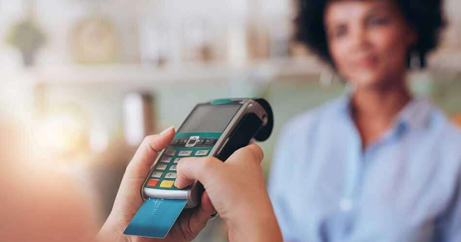 lady shops with debit card