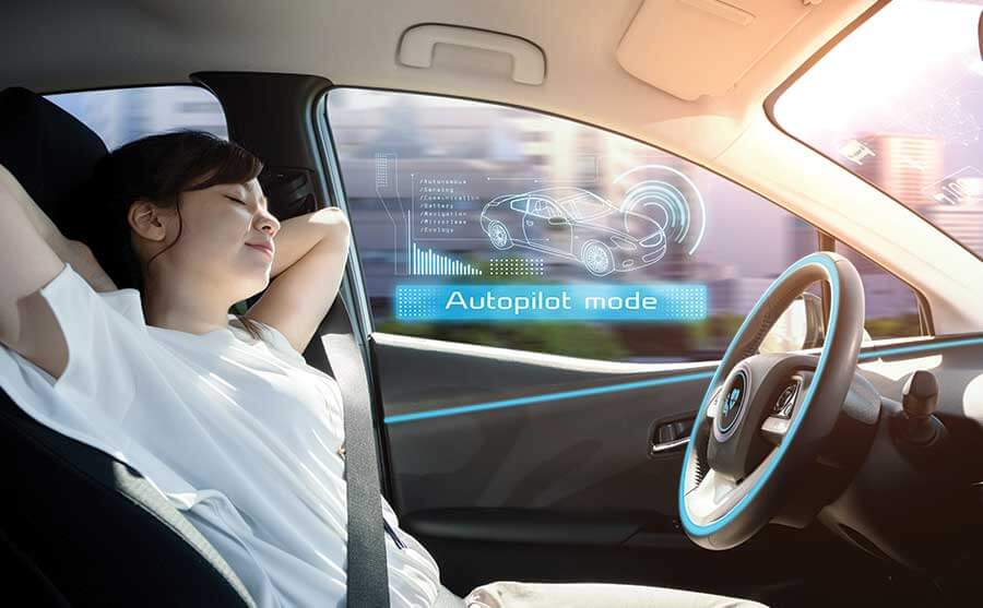 young lady naps while driving car on autopilot mode