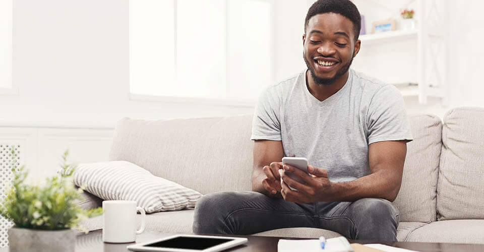 Young man using a smartphone to get a personal loan
