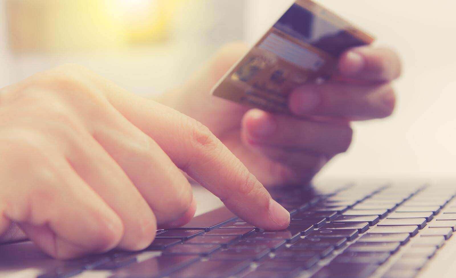 consumer enters debit card zip code on a laptop